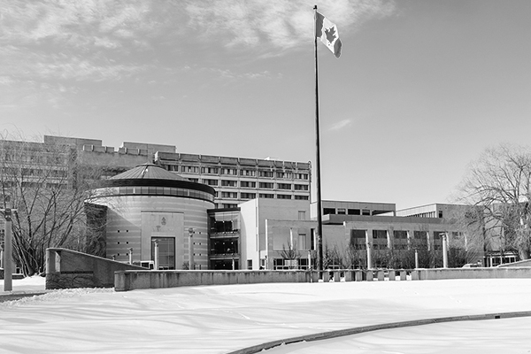 black and white photo of Vari Hall with the flag flying